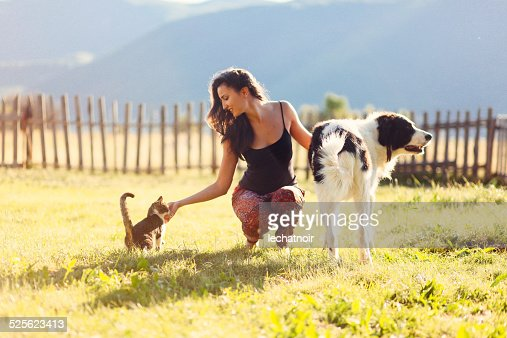 Young woman playing with her pet friends
