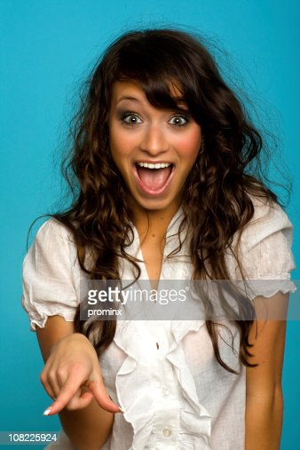 young woman pointing and laughing stock photo getty images