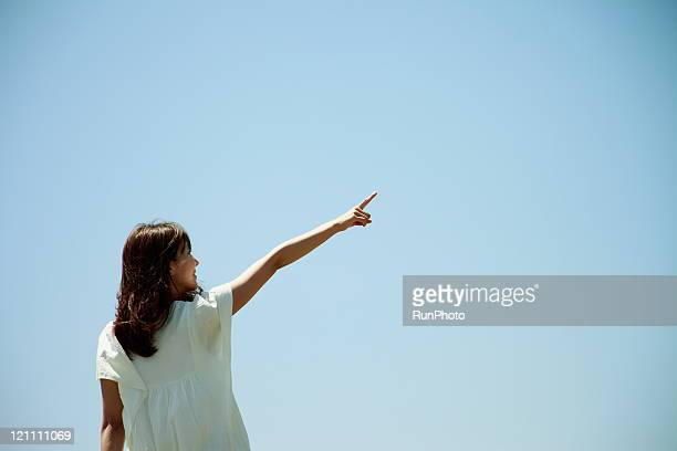 young woman pointing at the sky(profile)