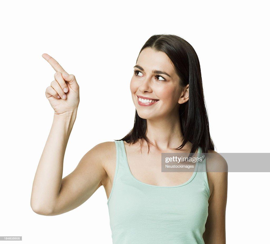 Jeune femme pointant loin isolé : Photo