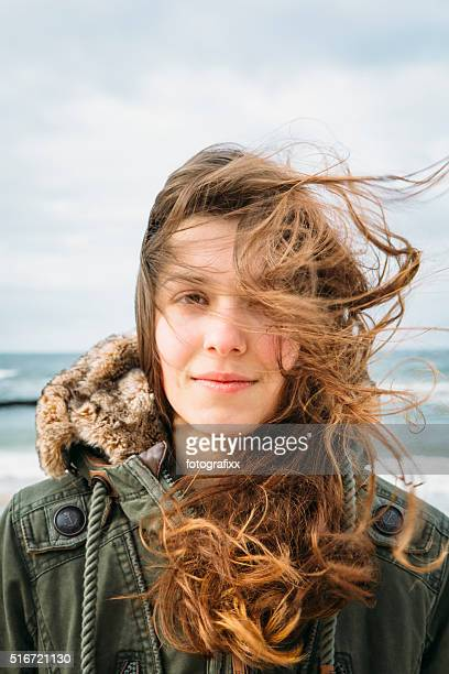 young woman portrait at the baltic with tousled hair