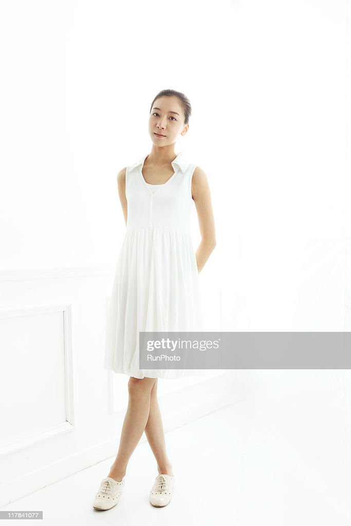 young woman portrait in the white room