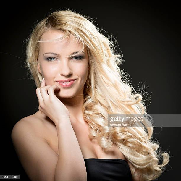 Young woman portrait with beautiful blond hair