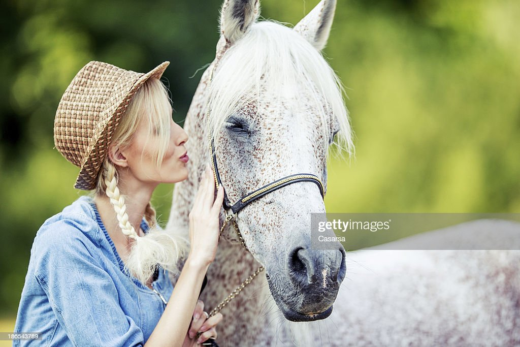 Young woman portrait with her horse : Stock Photo