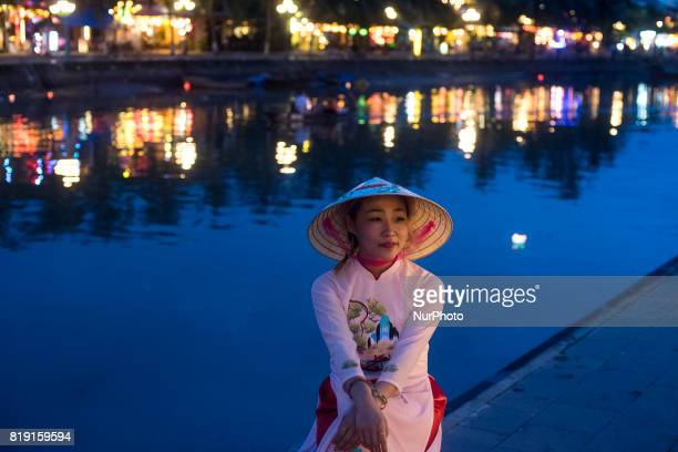 A young woman poses at the mouth of the Thu Bon River in Hoi An a small town on the coast of the South China Sea
