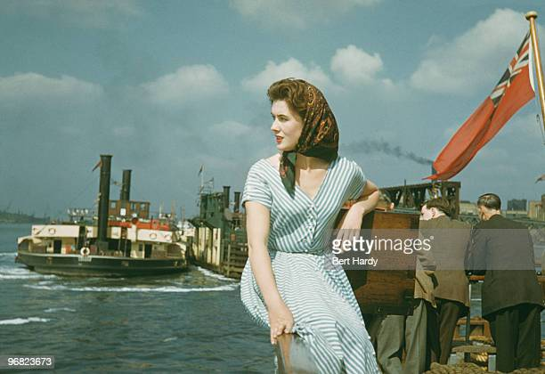 A young woman poses by the sea at Southend Essex July 1953 Original publication Picture Post 6611 Southend River Trip pub 1st August 1953