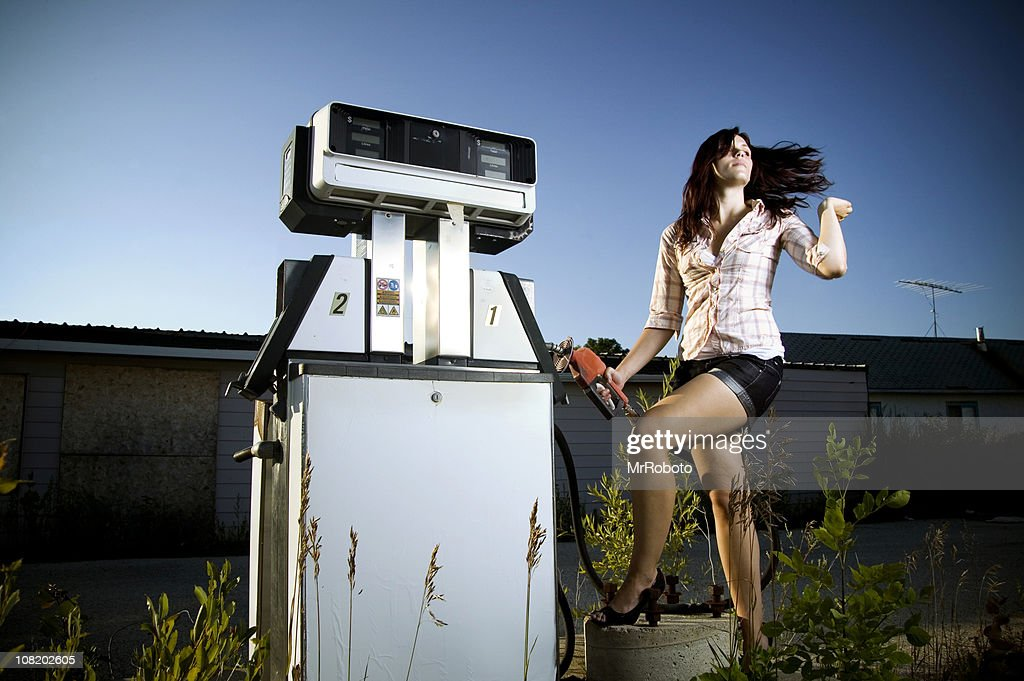 Young Woman Posing at Abandoned Gas Station