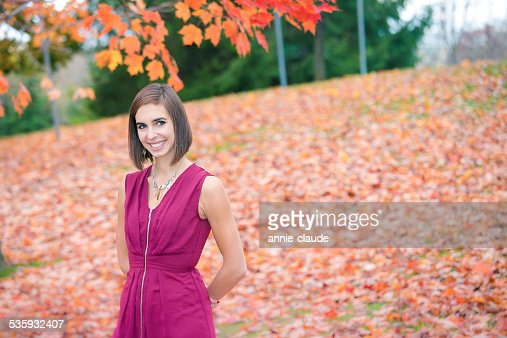 Young woman posing in a fall scene : Stock Photo