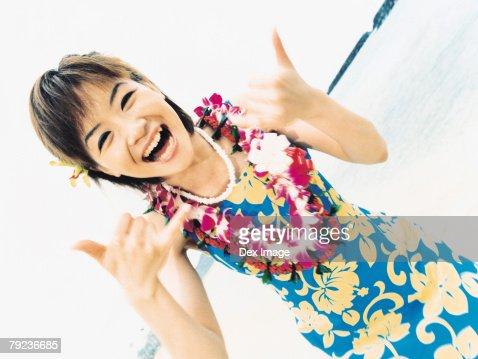 Young woman posing in Hawaiian blouse and garland : Stock Photo