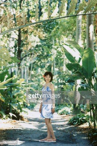 Young woman posing in Hawaiian blouse : Stock Photo