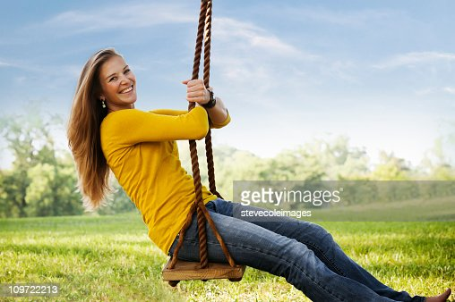 Young Woman Posing on a swing
