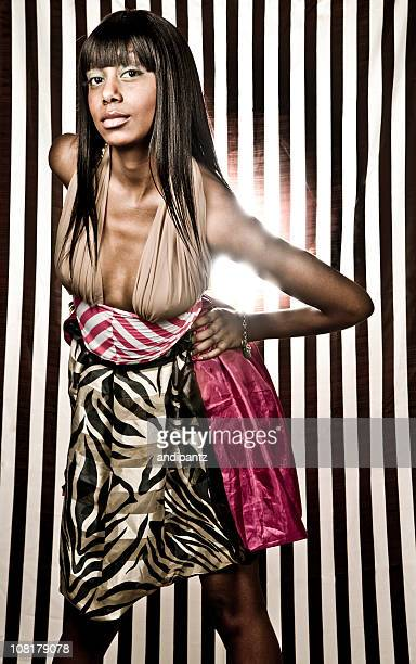 Young Woman Posing on Black and White Striped Background
