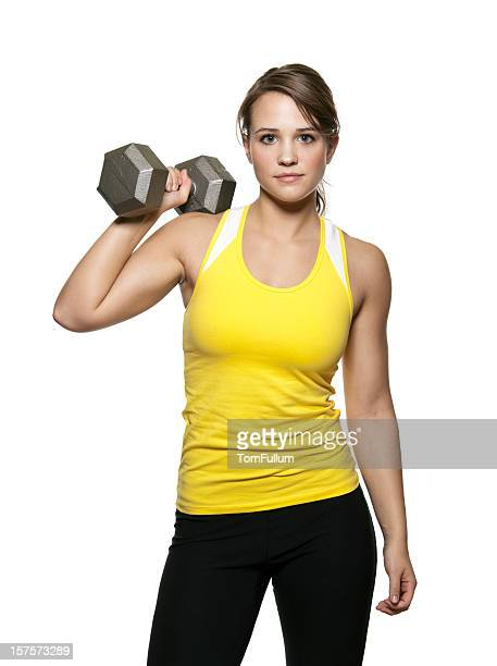 Young Woman Posing with Barbell
