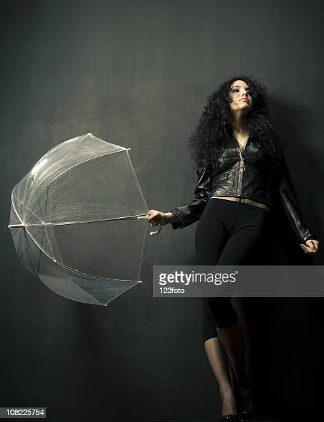 Young Woman Posing with Clear Umbrella