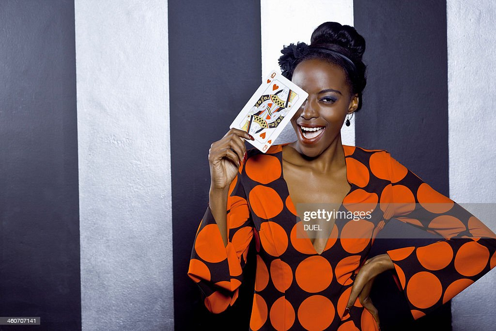Young woman posing with playing card : Stock Photo