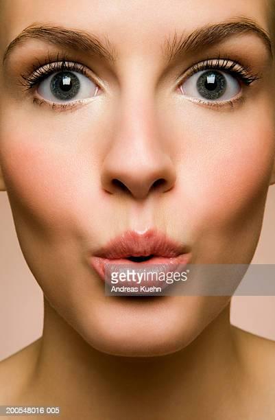 Young woman pouting, portrait, close-up