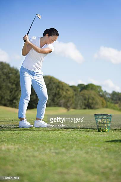 Young woman practice golf swing