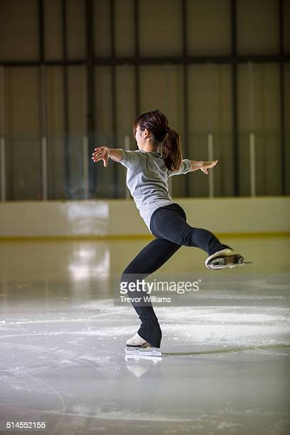 A young woman practicing her figure skating
