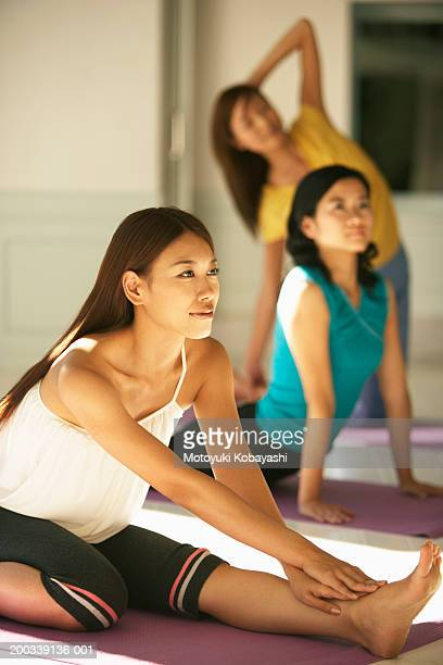 Young woman practicing oblique face one leg pose