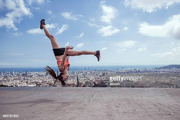 Young woman practicing parkour in the city of Barcelona