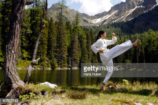 Young woman practicing tae kwon do