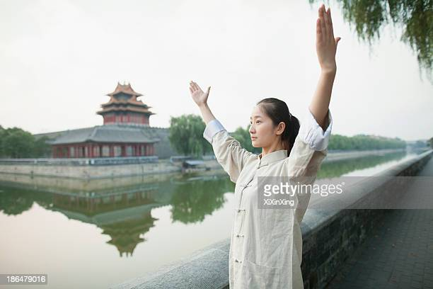 Young Woman Practicing Tai Ji