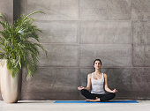Young girl meditating in yoga class
