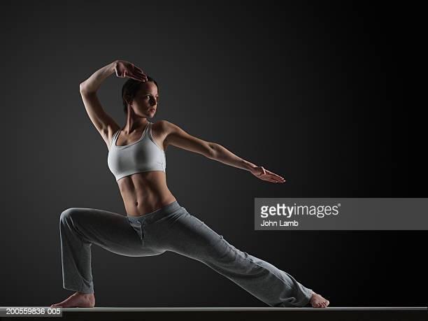 Young woman practising karate, close-up