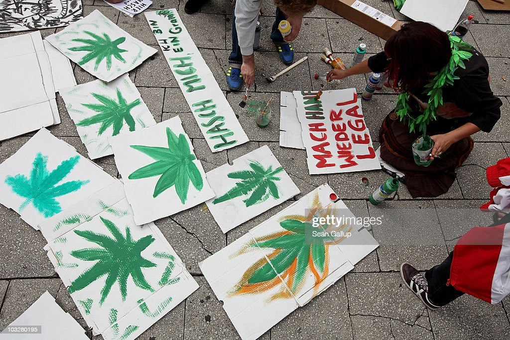 A young woman prepares signs, including one that reads: 'Make Hemp Legal Again' prior to marching in support of the legalization of marijuana in Germany during the annual Hemp Parade, or 'Hanfparade', on August 7, 2010 in Berlin, Germany. The consumption of cannabis in Germany is legal, though all other aspects, including growing, importing or selling it, are not. However, since the introduction of a new law in 2009, the sale and possession of marijuana for licenced medicinal use is legal.