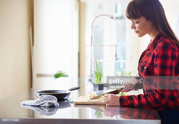 Young woman preparing food in the kitchen