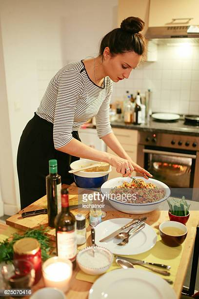 Young woman preparing food on the table