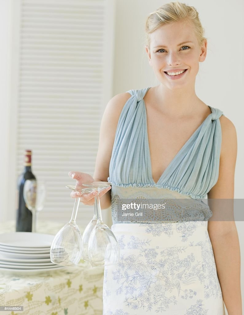 Young Woman preparing for a dinner party : Stock Photo