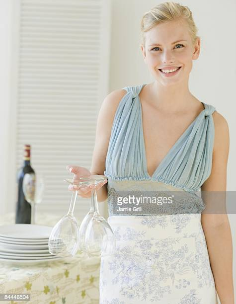 Young Woman preparing for a dinner party