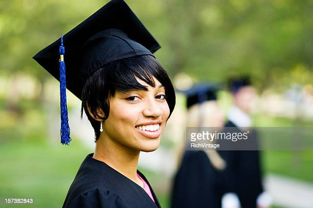 Young Woman Profile in Graduation Gown
