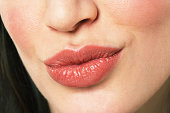 Young woman puckering lips, close-up