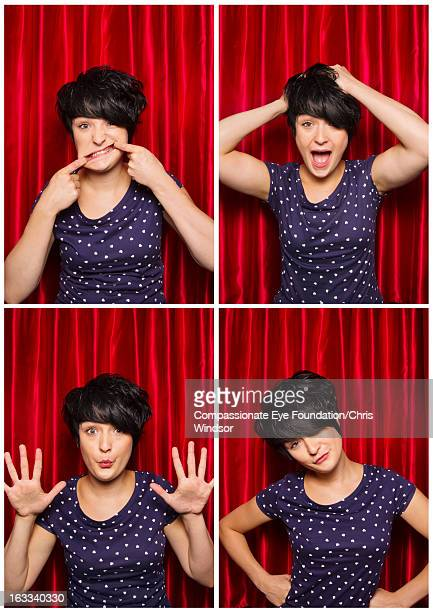 Young woman pulling faces in photo booth