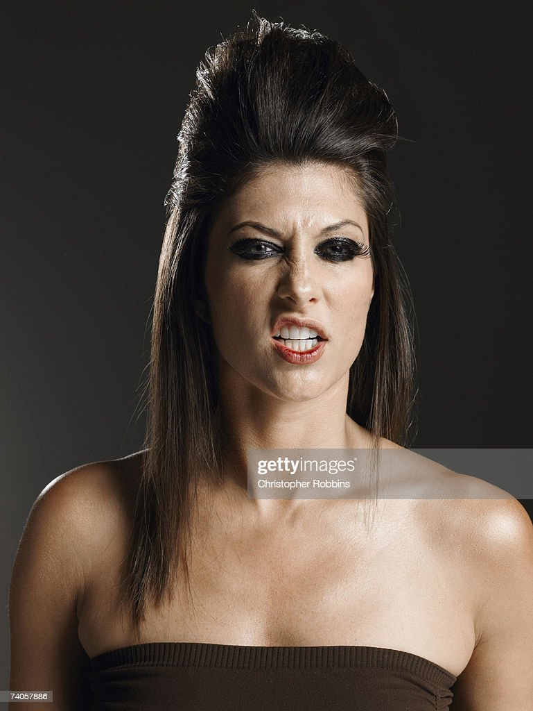 Young woman pulling facial expression : Stock Photo