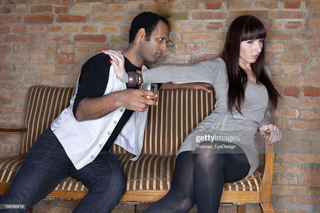 Young Woman Pushing Away a Drunk Man. : Stock Photo