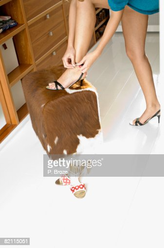 Young Woman Putting On High Heels Stock Photo | Getty Images