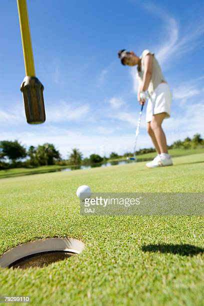 Young Woman Putting