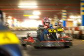Young woman racing on go cart track