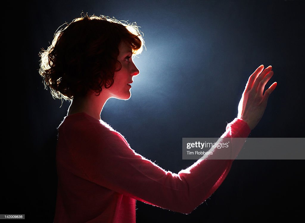 Young woman reaching her arm out. : Stock Photo
