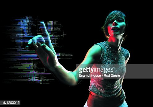 Young Woman Reaching Out to Push a Futuristic Touch Sensitive Computer Monitor Displaying Data : Bildbanksbilder