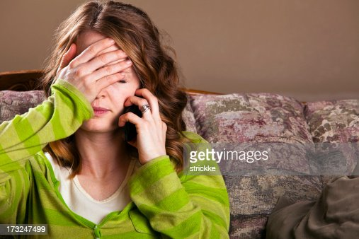 Young Woman Reacts to Mobile Phone Bad News
