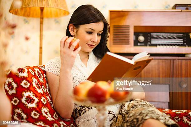 Young woman reading at home