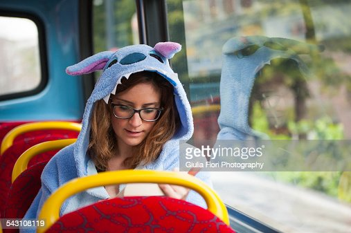 Young woman reading book on a bus