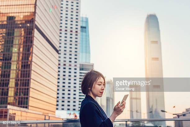 Young woman reading email on phone