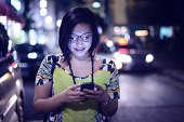 Young woman reading from smart phone