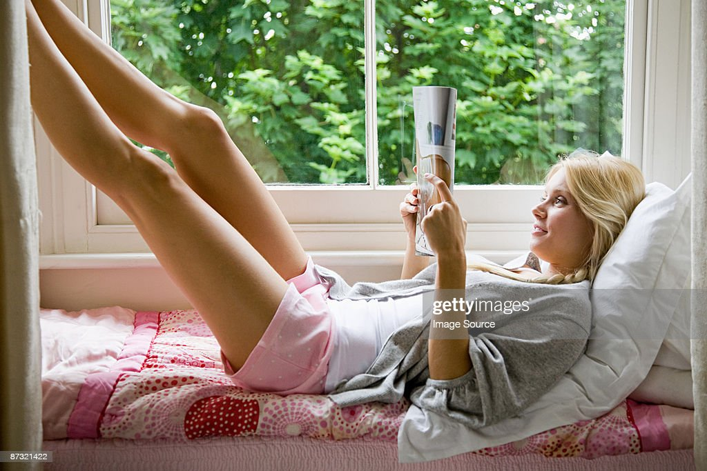 Young woman reading : Stock Photo