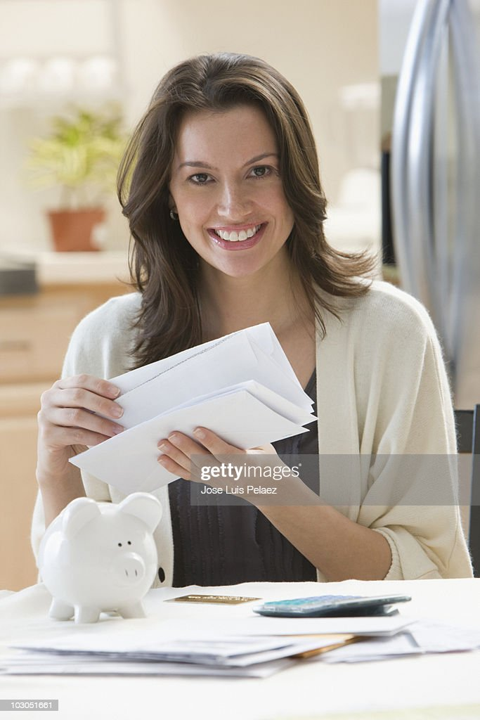 Young woman reading the mail : Stock Photo
